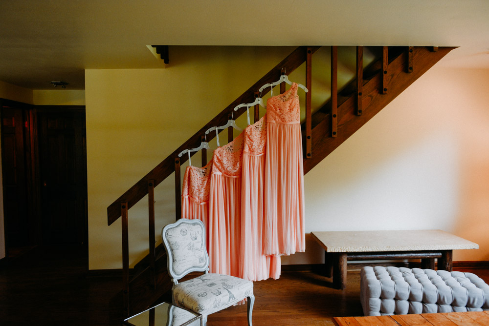 bridesmaid dresses hanging at landing 1841 wedding in burlington