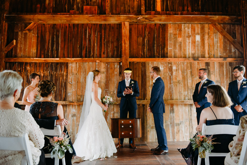 officiant in remodeled barn with natural light