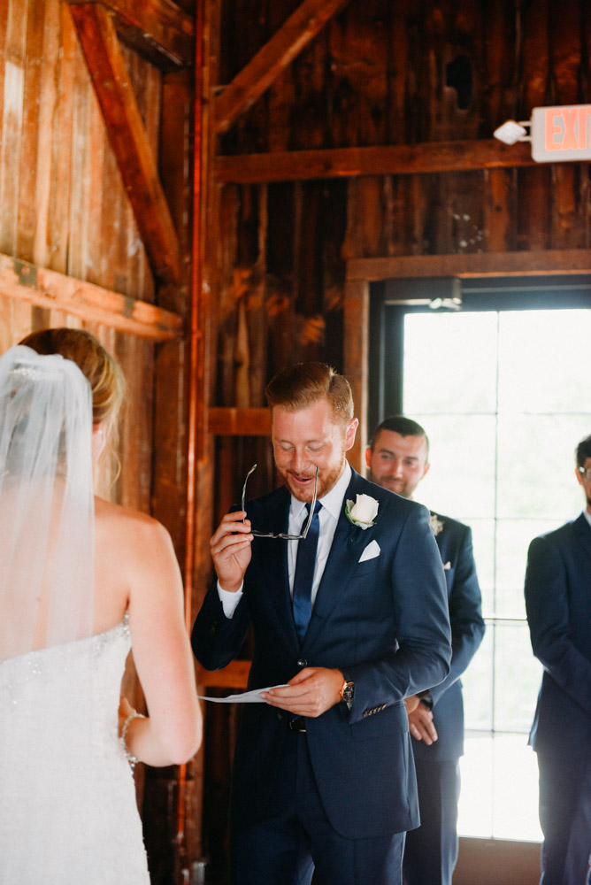 groom reading with glasses
