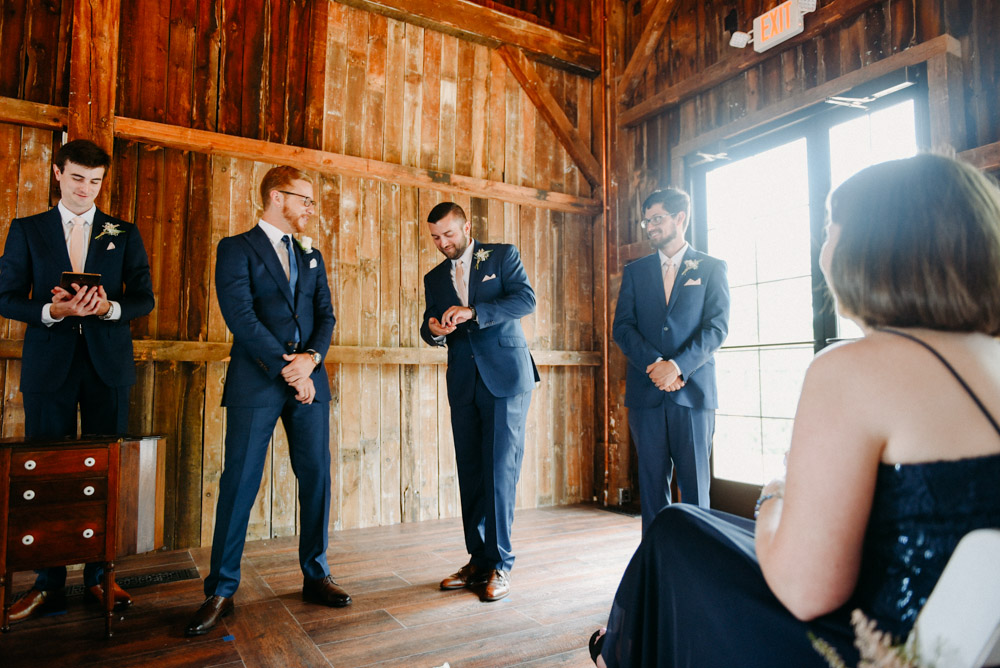 best man giving rings to groom