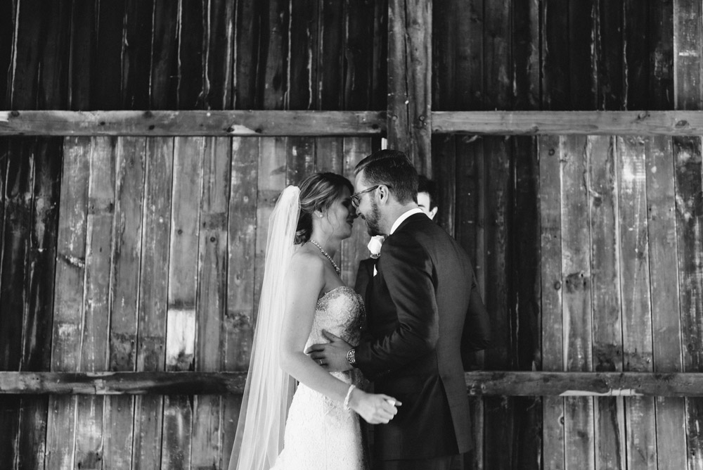 bride and groom in rustic barn