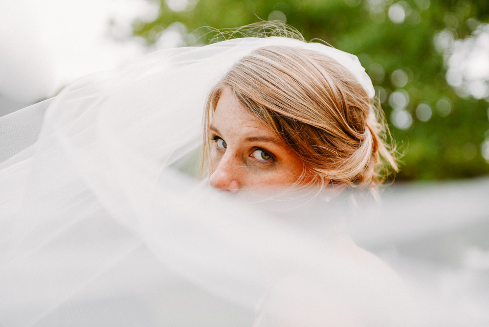 bride portrait with veil at landing 1841 wedding