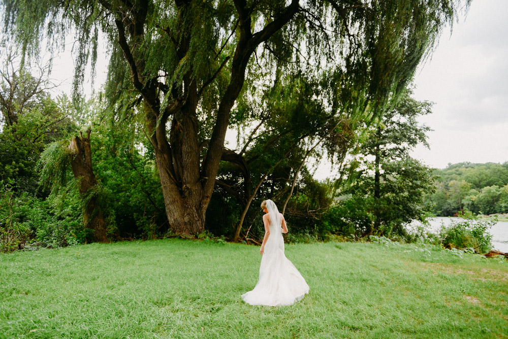 bride under giant willow tree in burlington