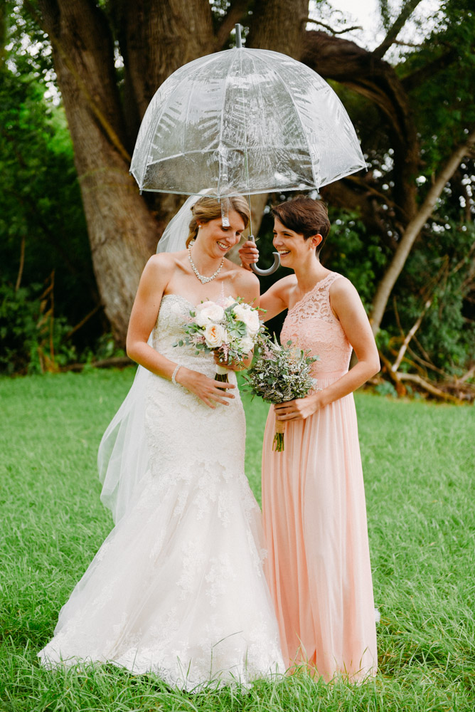 wedding photos in rain with umbrella