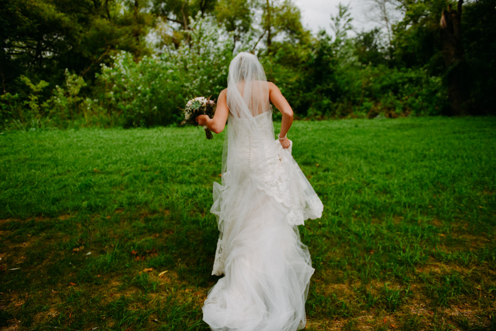 vintage photo of bride walking through field