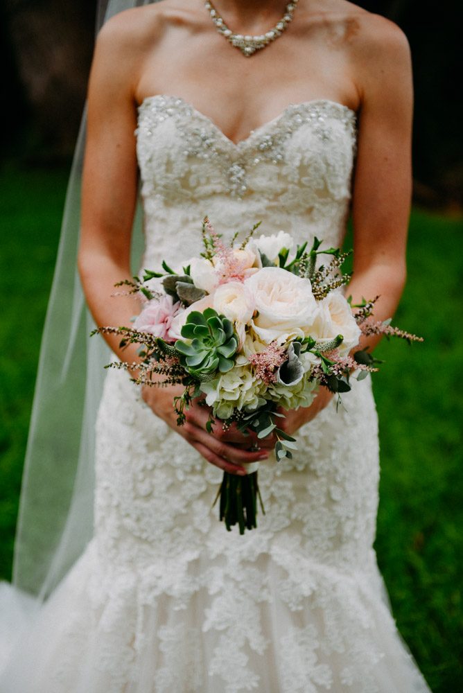 bridal bouquet with lace dress and succulents