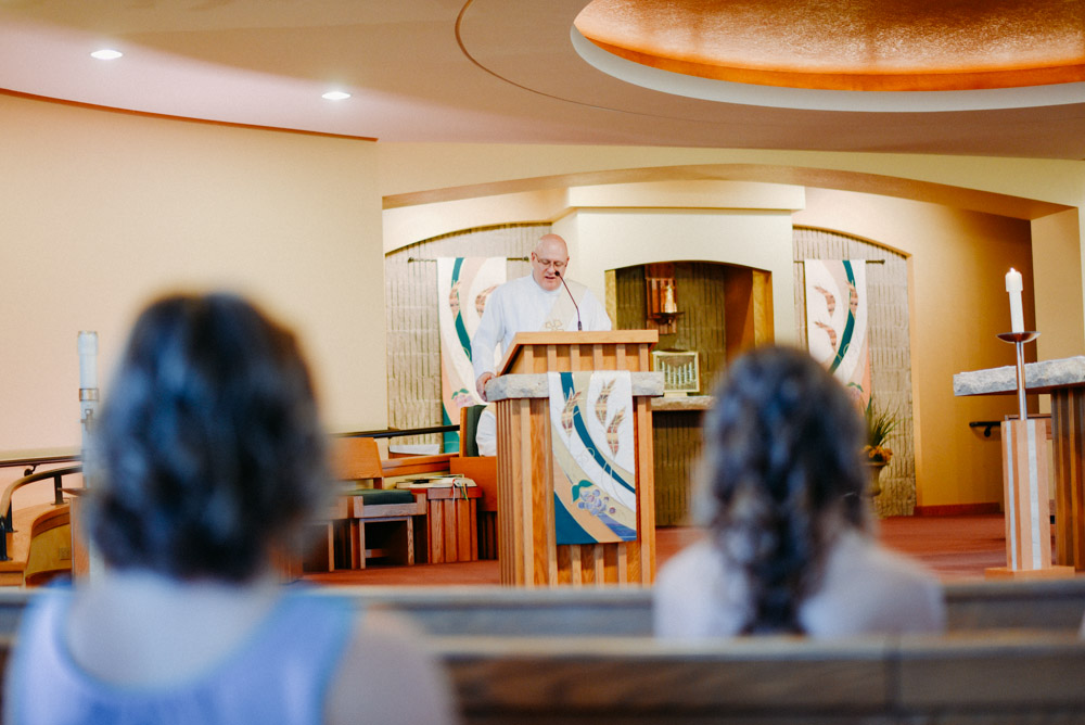 priest at pulpit during wedding