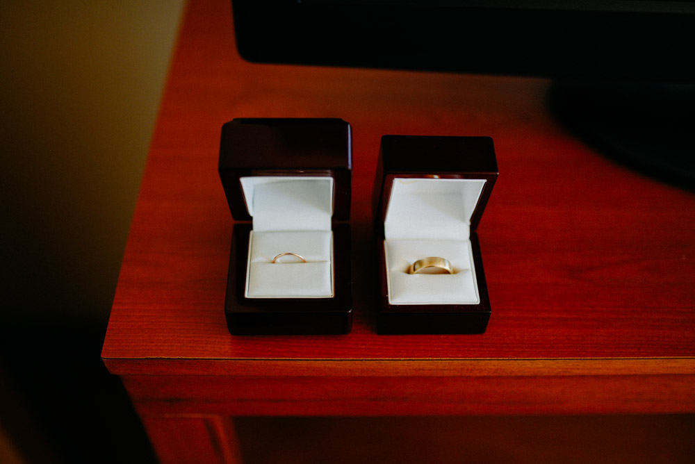 bride and groom wedding bands in boxes