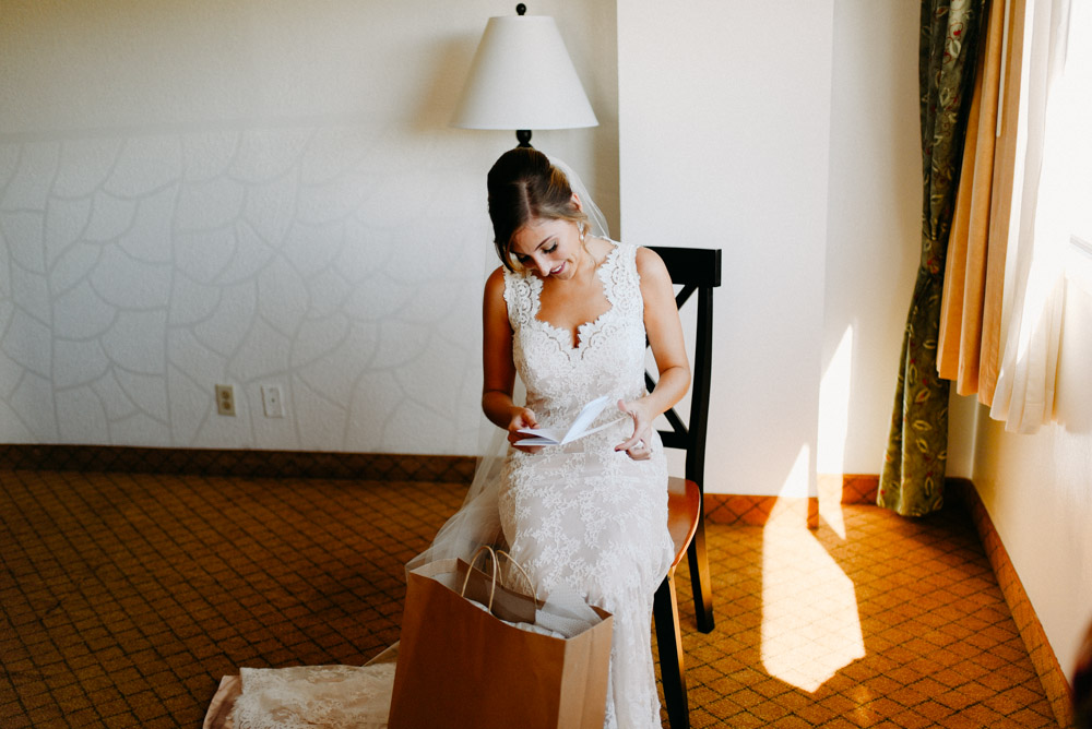 bride reading letter to groom