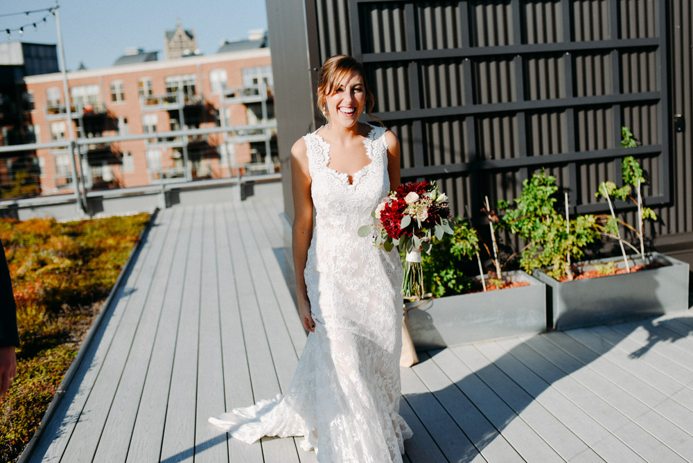 laughing bride on 88 nine rooftop
