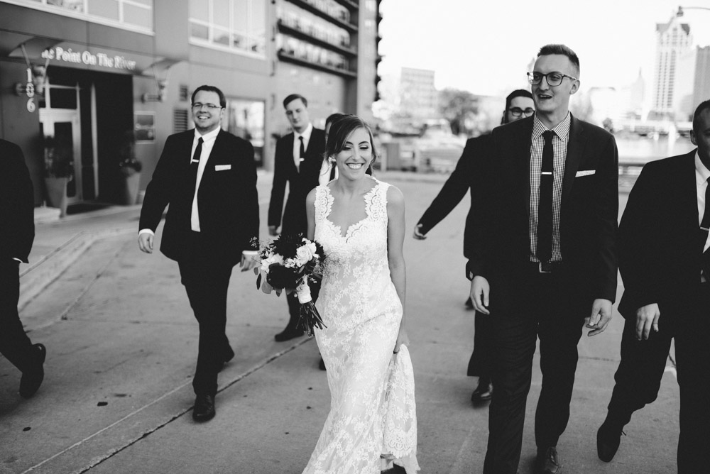black and white photo of laughing wedding party