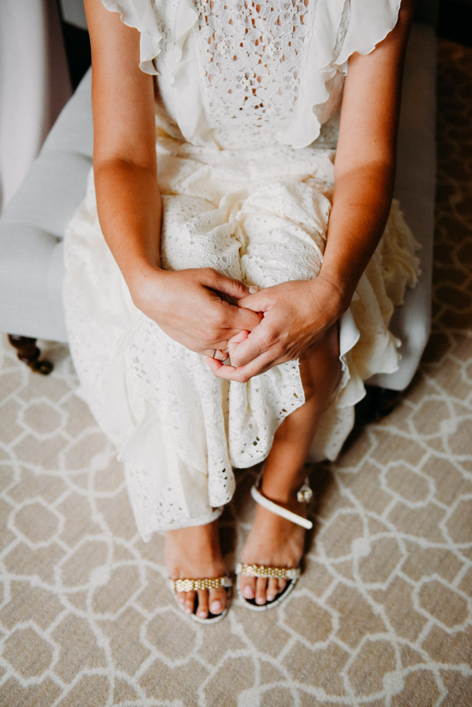 bride holding knees in wedding dress