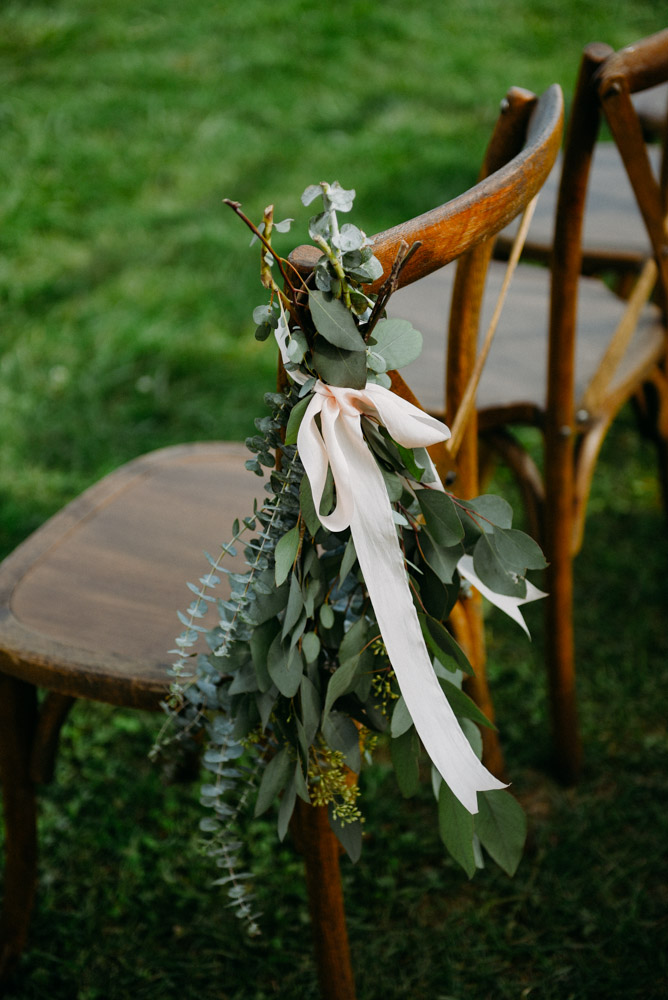 eucalyptus with pink ribbon on ceremony aisle