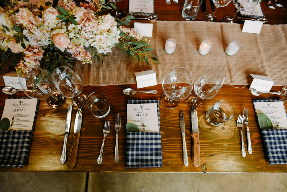 wedding reception table setting with plaid napkins
