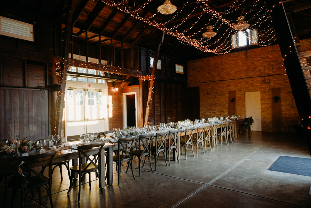 long rustic banquet table at lake forest farm wedding