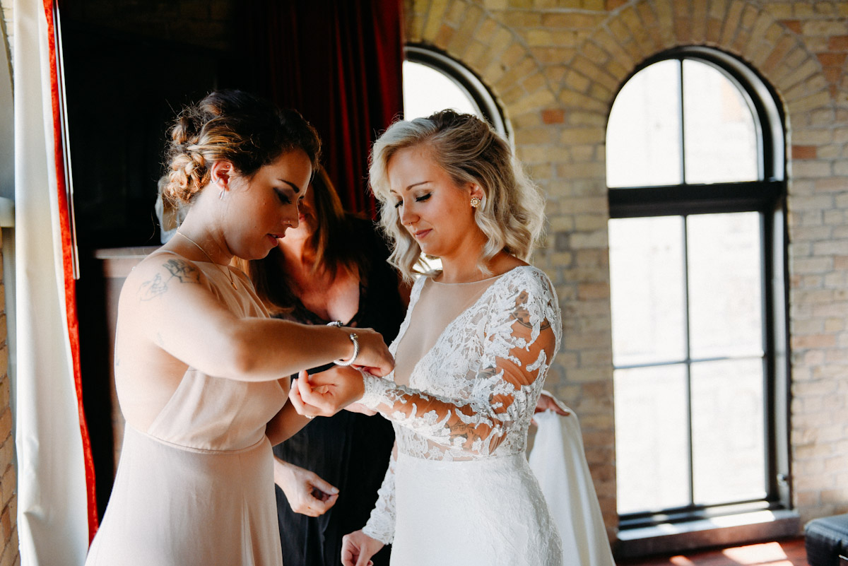 bride with thick lace sleeve wedding dress
