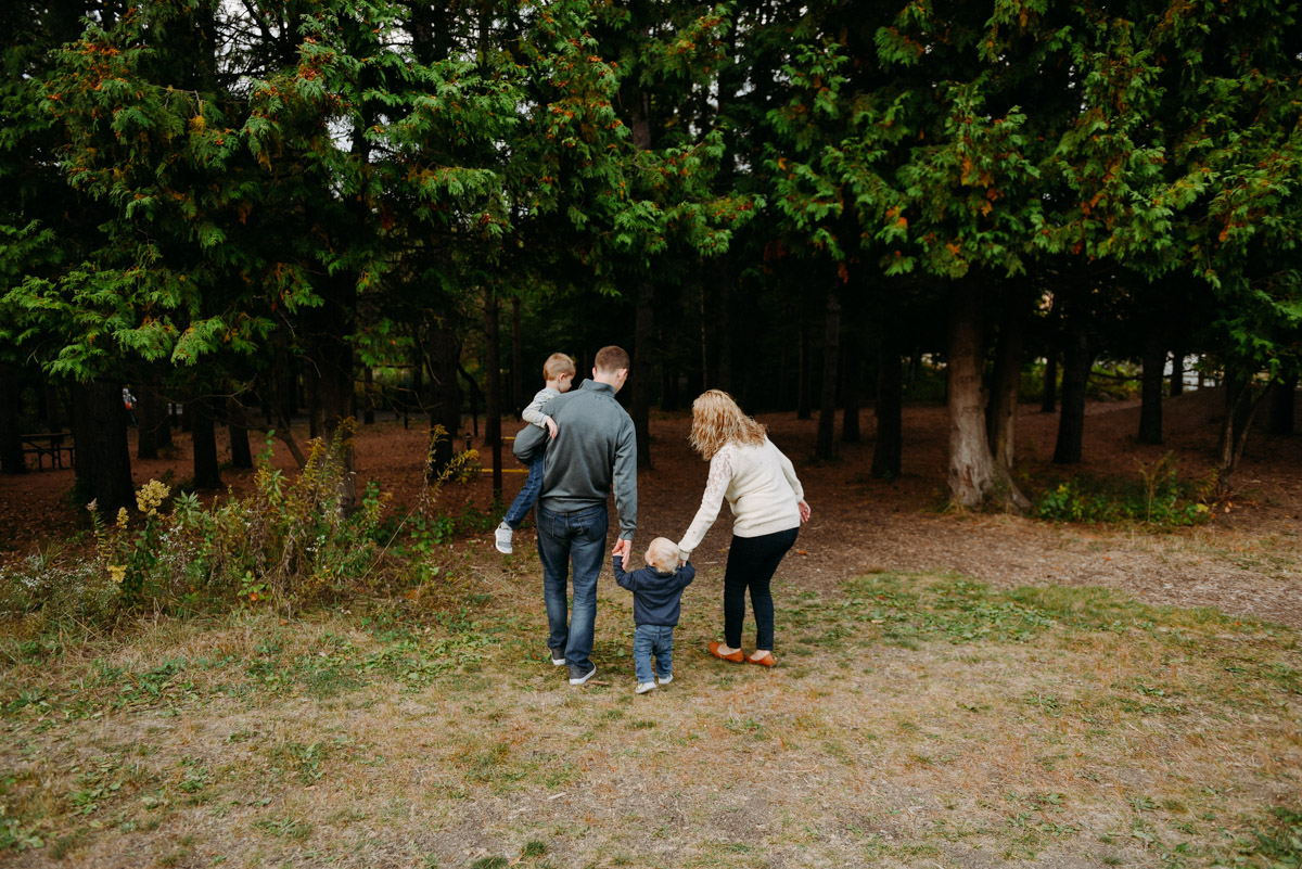 family walking into forest