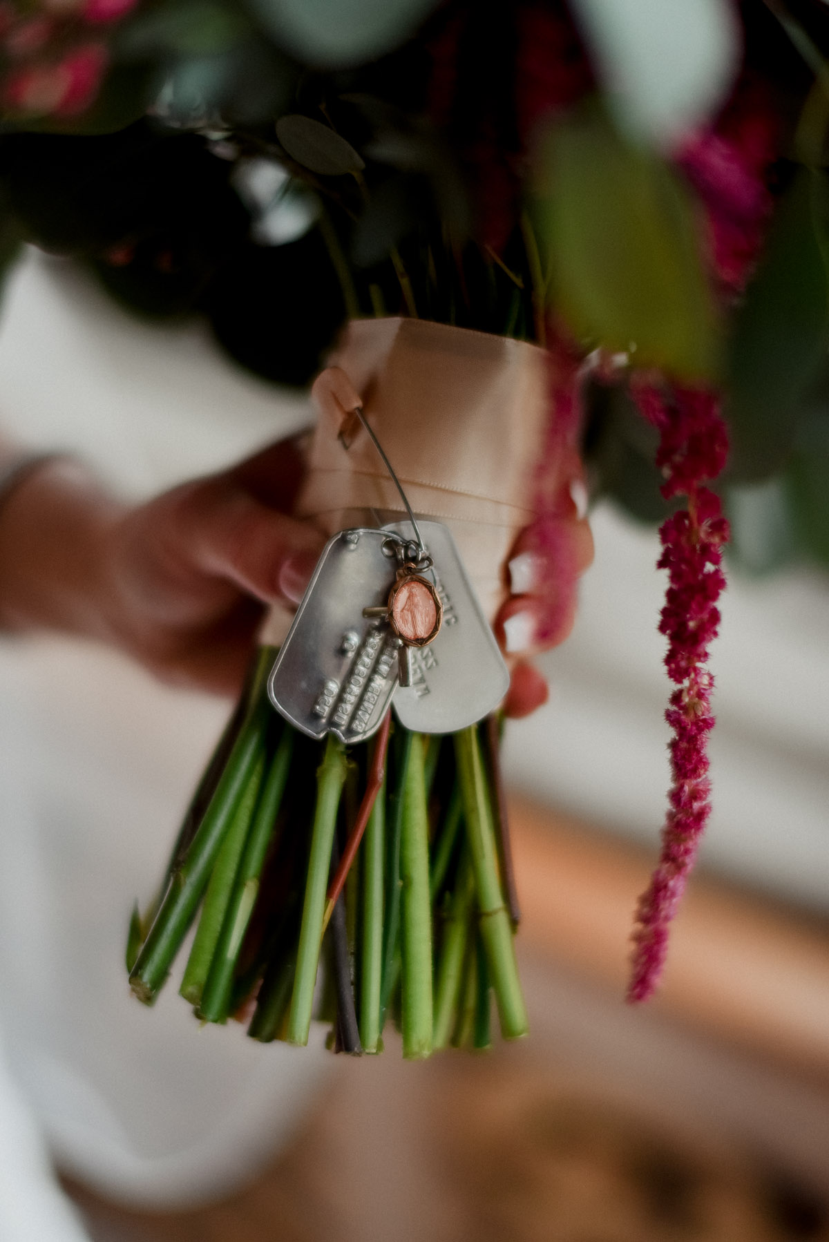 dog tags on bridal bouquet