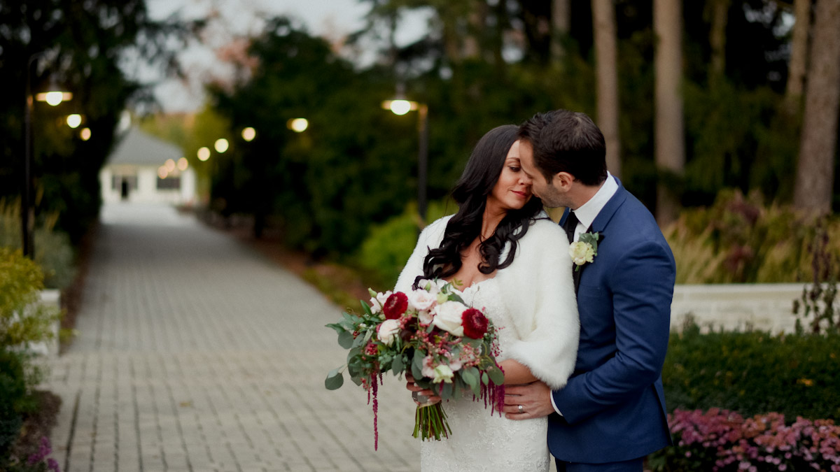 bride and groom with burgundy accent color