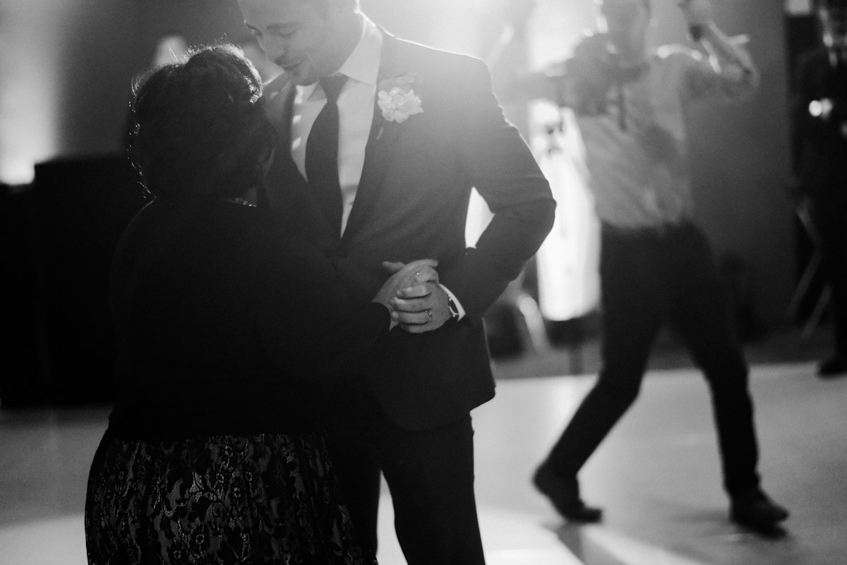 intimate photo of groom dancing with mother
