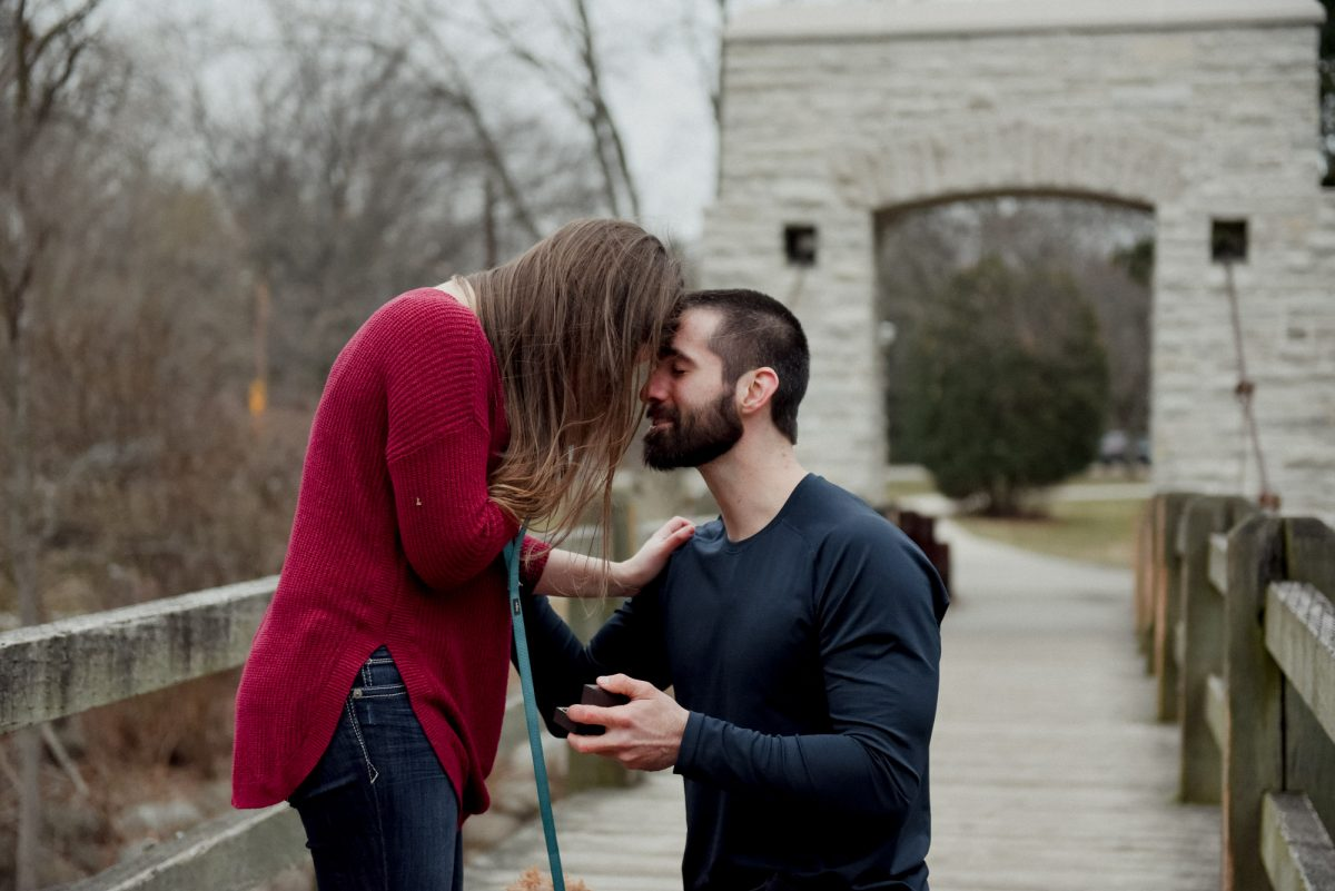 emotional man and woman during surprise proposal
